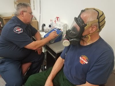 Mike Reigle, Key Peninsula Fire Department, using the PortaCount Respirator Fit Tester