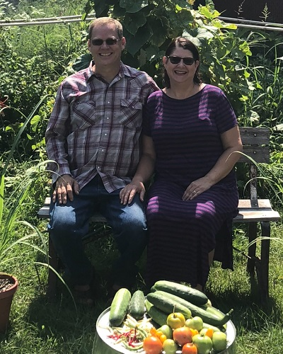 TSI's Terry Harstad and his wife Doris in their garden