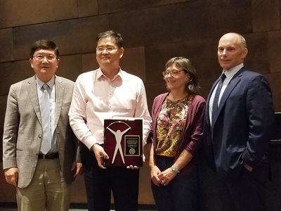 Dr. David Pui (L. M. Fingerson/TSI Chair in Mechanical Engineering), Dr. Hong He, Dr. Susan Mantell (Mechanical Engineering Department Head), and Dr. Tom Kennedy (President/CEO, TSI Incorporated)