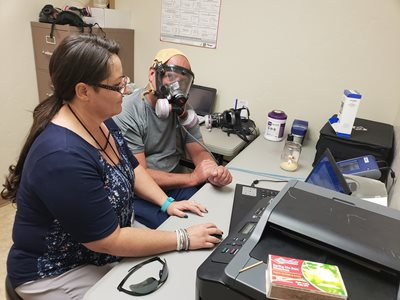 Nurse Practitioner Alec Rimmasch preparing to use the PortaCount Respirator Fit Tester