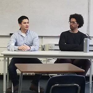TSI's Joseph Kwong (L) speaks to students about software engineering